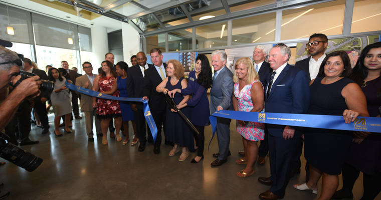 Chancellor Newman and dignitaries cut the ribbon on the Residence Halls
