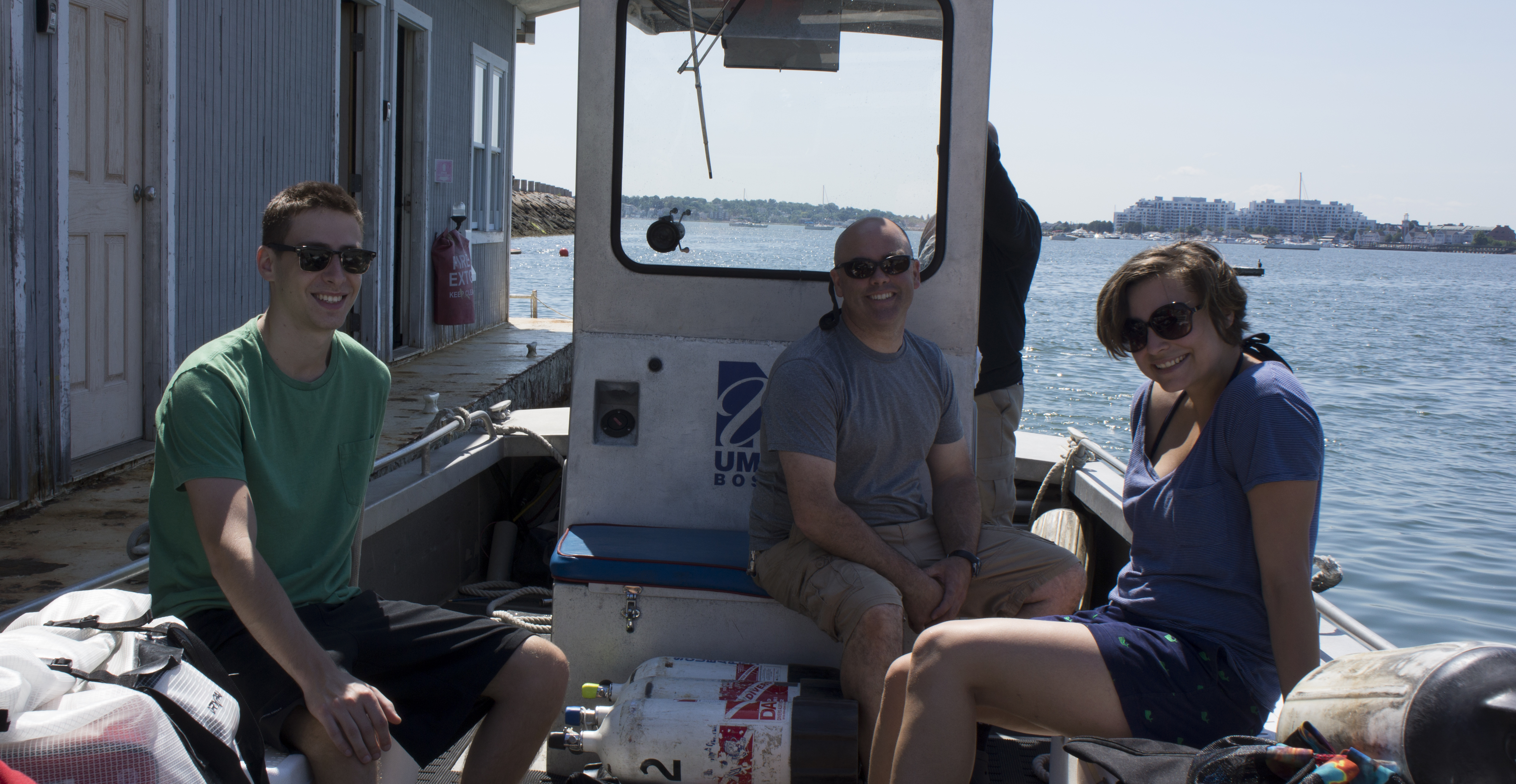 Dov Sotkowitz, Ted Lyman, and Lisa Valdez prepare for a dive in Boston Harbor.