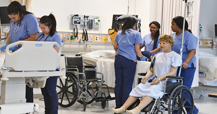 Nursing students in the sim lab