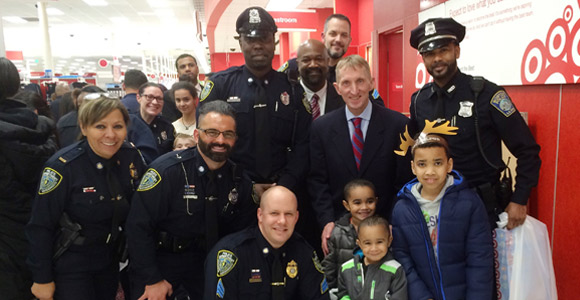 Police Commissioner William Evans (right) with members of UMass Boston's Department of Public Safety and area youth