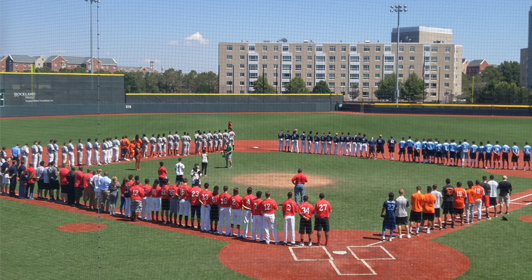 Teams taking part in the 2nd annual BASE Urban Baseball Classic line the bases at Monan Park.