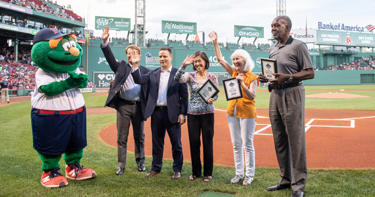 The 2019 Bay State Games Hall of Fame inductees, with Wally the Green Monster at left. Charlie Titus is to the far right.