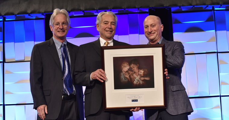 Professor Ed Tronick receives his award from ZERO TO THREE Board President Ross Thompson and ZERO TO THREE Executive Director Matthew Melmed