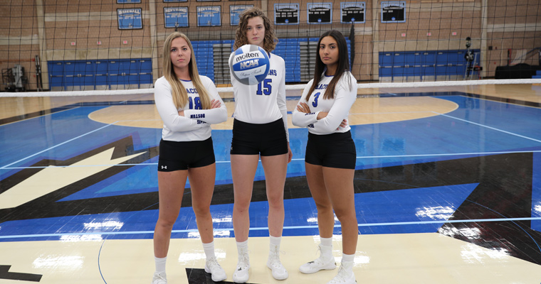 Volleyball seniors pose on the court