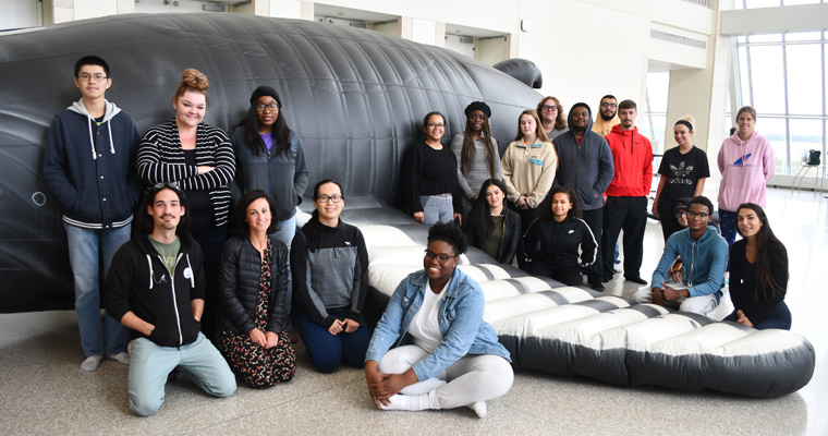 UMass Boston class outside the Whalemobile