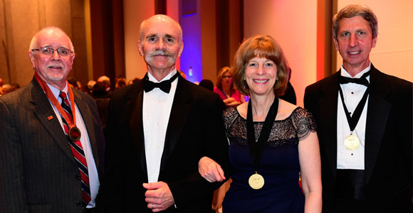 Jack Wiggin (far right) was inducted into the College of Fellows in April.