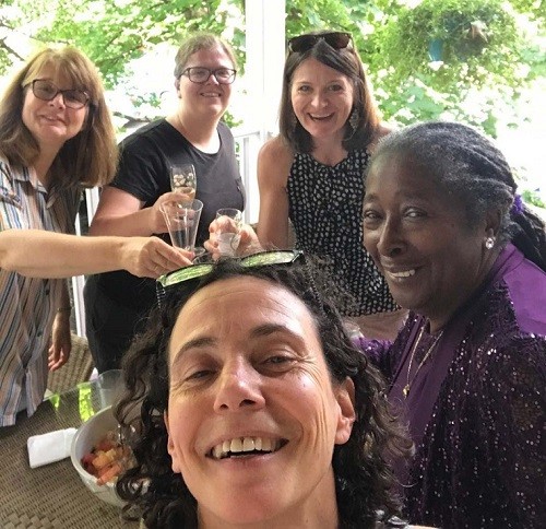Julie Lietman and Amy Whitish-Temple with Lurlene, Brittany, and Ksenija on a porch for a brunch for Lurlene's retirement.