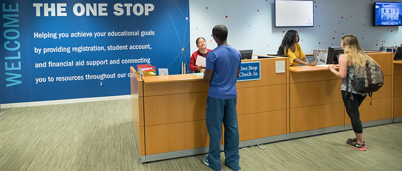 UMass Boston students check in at The One Stop, which provides financial aid, registrar, and the Bursar's Office answers in one location.