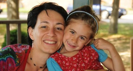 Associate Professor of Psychology Zsuzsanna Kaldy and a three-year-old girl. Both have radiant smiles.