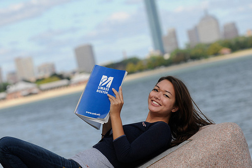 Picture of girl with a planner with the Boston city skyline in the background