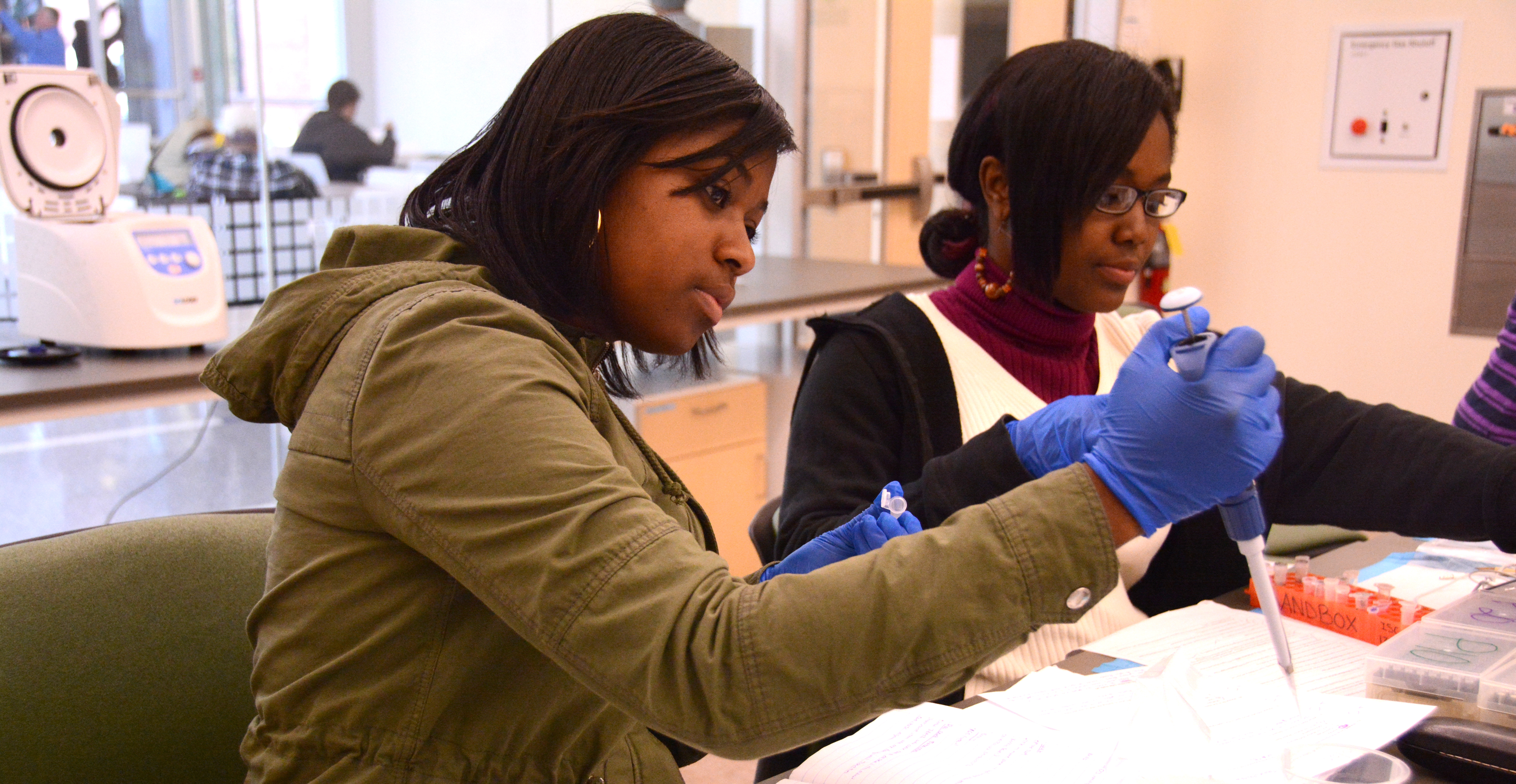Two students use pipettes in the Sandbox Lab