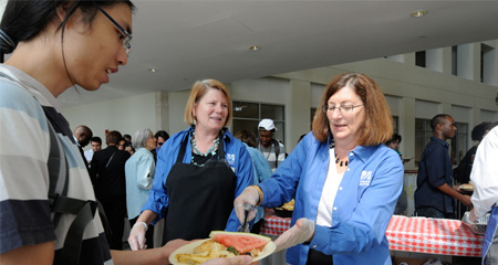 Vice Chancellor for Enrollment Management Kathleen Teehan serves up lunch during the 2011 Fall Convocation.