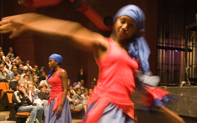 Students Belinda Valcourt and Nora Gray perform a traditional Haitian dance at Cambridge Rindge and Latin School in 2006.