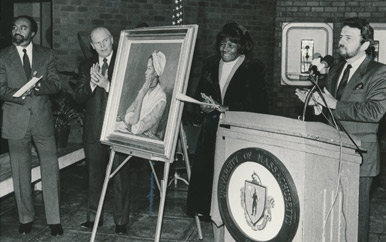 The day Wheatley Hall was dedicated (February 1, 1985), UMass Boston Chancellor Robert A. Corrigan (far right) presented a portrait of Phillis Wheatley to hang in Wheatley Hall.