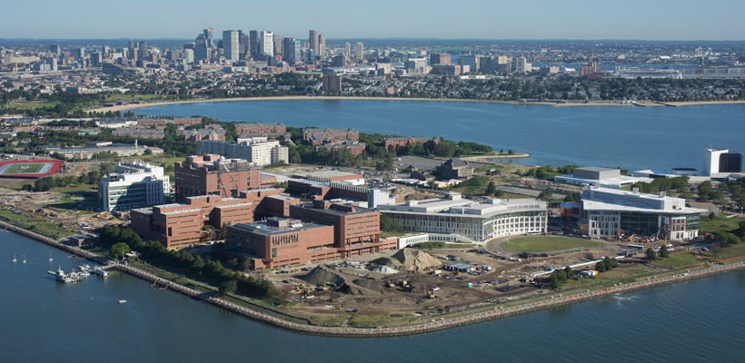 UMass Boston's waterfront campus, with Boston's skyline as a backdrop