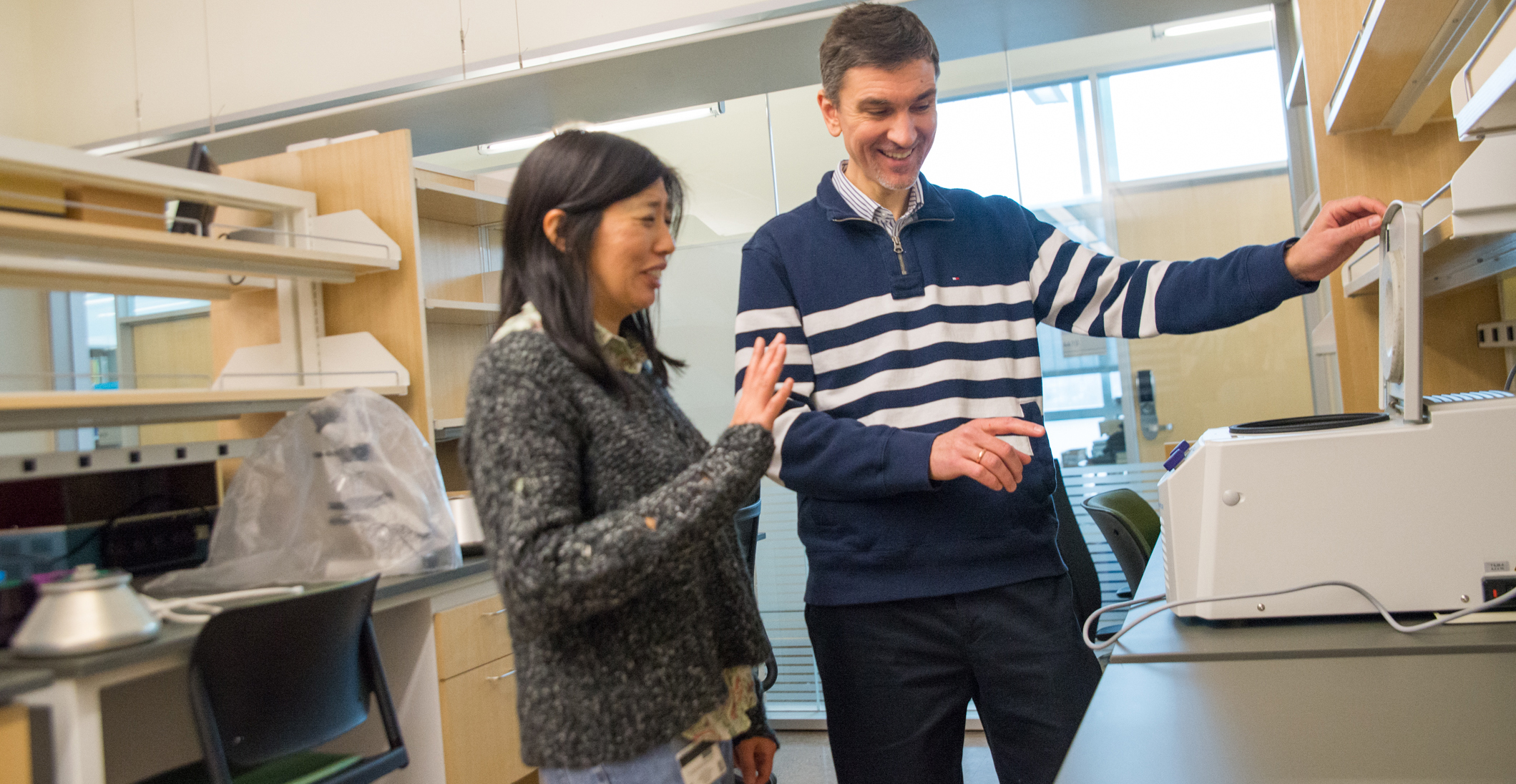Linda Huang and Alexey Veraksa examine equipment in the ISC
