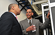 Richard Anderson, right, shows Governor Deval Patrick the server room in the Venture Development Center.