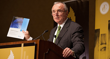 UMass Boston alumnus Bill Bratton, the only person to lead both the NYPD and LAPD, speaks at a podium.