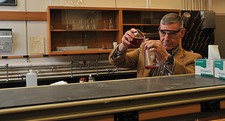 Robert Carter works in one of UMass Boston's chemistry labs.