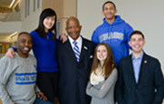 Chancellor J. Keith Motley is surrounded by students who made UMass Boston their first choice.