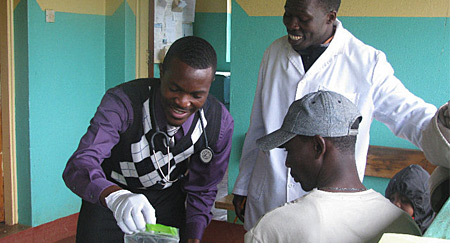 A UMass Boston student volunteers at a free clinic through Kenya Heart and Sole, one of the college's global initiatives.