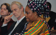 Padraig O'Malley sits next to African peace activist Leymah Roberta Gbowee before her address.