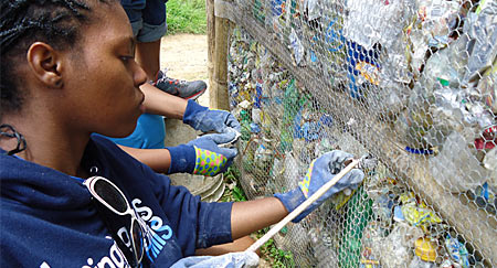 A group of UMass Boston-based Upward Bound students traveled to Guatemala to build a school out of recycled materials.